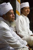 Bali, Indonesia.  Two Hindu Priests.  Pura Dalem Temple, Dlod Blungbang Village.