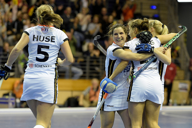 Berlin, Germany, February 10: During the FIH Indoor Hockey World Cup semi-final match between Belarus (dark blue) and Germany (white) on February 10, 2018 at Max-Schmeling-Halle in Berlin, Germany. Final score 2-3. (Photo by Dirk Markgraf / www.265-images.com) *** Local caption *** Luisa STEINDOR #6 of Germany, Marie MAEVERS #23 of Germany, Viktoria HUSE #5 of Germany