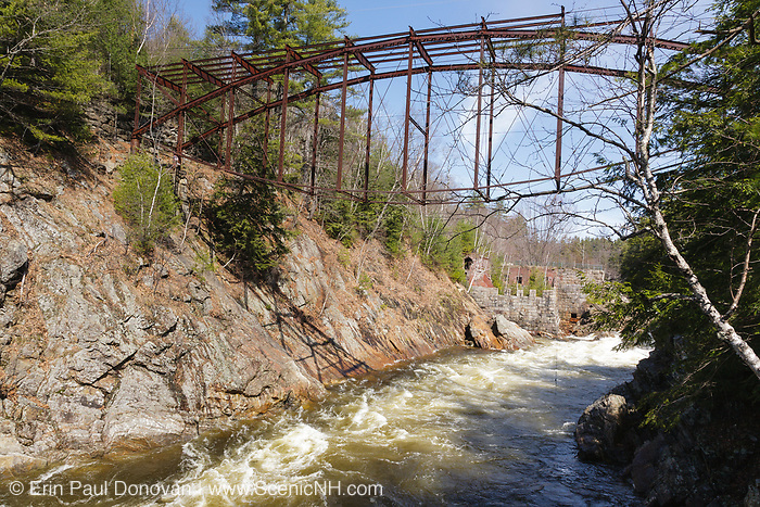 """Remnants of the """"Pumpkin Seed Bridge"""" at Livermore Falls in Campton, New Hampshire. This bridge was erected in 1886 by the Berlin Iron Bridge Company and crossed the Pemigewasset River. It is 263 feet long and closed 1959."""