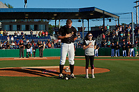 Batavia Muckdogs starting pitcher Andrew Miller (8) stands with a young fan during the national anthem before a NY-Penn League game against the State College Spikes on July 1, 2019 at Dwyer Stadium in Batavia, New York.  Batavia defeated State College 5-4.  (Mike Janes/Four Seam Images)