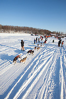 Anitra Winkler leaves the start line of the Junior Iditarod  at Knik Lake, Knik, Alaska