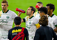 LOS ANGELES, CA - SEPTEMBER 13: Diego Valeri #8 of the Portland Timbers enjoys some water during a game between Portland Timbers and Los Angeles FC at Banc of California stadium on September 13, 2020 in Los Angeles, California.