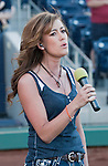 Siena Hardy sings the national anthem before the Reno Aces vs Sacramento River-Cats game played on Saturday night, April 21, 2012 in Reno, Nevada.
