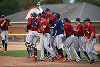 Mahoning Valley Scrappers players, including Jonathan Teaney (30), Jason Rodriguez (20), Nolan Jones (10), Francisco Perez (jacket), Ernie Clement (24), and James Karinchak (right) celebrate winning the division title during the second game of a doubleheader against the Batavia Muckdogs on September 4, 2017 at Dwyer Stadium in Batavia, New York.  Mahoning Valley defeated Batavia 6-2 to clinch the Pinckney Division Title.  (Mike Janes/Four Seam Images)