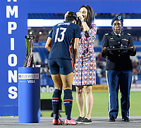 FRISCO, TX - MARCH 11: Lynn Williams #13 of the United States receives her medal during a game between Japan and USWNT at Toyota Stadium on March 11, 2020 in Frisco, Texas.