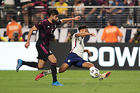 LAS VEGAS, NV - AUGUST 1: Nicholas Gioacchini #8 of the United States is defended by Nestor Araujo #2 of Mexico during a game between Mexico and USMNT at Allegiant Stadium on August 1, 2021 in Las Vegas, Nevada.