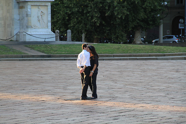 Couple flirting under the arch in Milan, Italy. .  John offers private photo tours in Denver, Boulder and throughout Colorado, USA.  Year-round. .  John offers private photo tours in Denver, Boulder and throughout Colorado. Year-round.