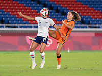 YOKOHAMA, JAPAN - JULY 30: Lynn Williams #21 of the USWNT is defended by Lieke Martens #11 of the Netherlands during a game between Netherlands and USWNT at International Stadium Yokohama on July 30, 2021 in Yokohama, Japan.