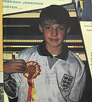 BNPS.co.uk (01202 558833)<br /> Pic: StaceysAuctioneers/BNPS<br /> <br /> The Roy of the Rovers prize winner Jonathan Austen<br /> <br /> The tear-stained football shirt worn by Gary Lineker for England's famous 1990 World Cup semi-final match against Germany has sold for £2,500.<br /> <br /> The star striker wore the white Umbro top throughout the game in which he scored England's equaliser and consoled a tearful Paul Gascoigne.<br /> <br /> After England returned home having lost on penalties to Germany in the semi-final, the Match of the Day presenter offers his number 10 shirt as a competition prize.
