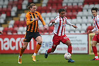 Terence Vancooten of Stevenage and Tom Eaves of Hull City during Stevenage vs Hull City, Emirates FA Cup Football at the Lamex Stadium on 29th November 2020