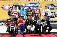 Sept. 16, 2011; Concord, NC, USA: The ten championship contenders in NHRA pro stock motorcycle (front row from left) Matt Smith , Hector Arana , Jerry Savoie , Michael Phillips , Jim Underdahl (rear row from left) Eddie Krawiec , L.E. Tonglet , Karen Stoffer , Andrew Hines and Hector Arana Jr pose for a group photo during qualifying for the O'Reilly Auto Parts Nationals at zMax Dragway. Mandatory Credit: Mark J. Rebilas-US PRESSWIRE