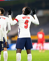 13th October 2020; Molineux Stadium, Wolverhampton, West Midlands, England; UEFA Under 21 European Championship Qualifiers, Group Three, England Under 21 versus Turkey Under 21; Eddie Nketiah of England with his hands in the air after scoring in the last minutes of the match for 2-0