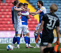 24th April 2021; Ewood Park, Blackburn, Lancashire, England; English Football League Championship Football, Blackburn Rovers versus Huddersfield Town; Brackburn's  Adam Armstrong (7) clebrates with team mates after scoring his third goal in the 60th minute to make the score 5-1 to Blackburn with Mustapha Olagunju of Huddersfield Town on his knees watching on