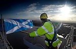 Pic Kenny Smith...... 24/11/2008 Riggers Chris Ronxin and Kenny Sharp hoist the Saltire high above the Forth Road Bridge to celebrate St Andrews day, their hasn't been a flag flown on the bridge for 5 years.
