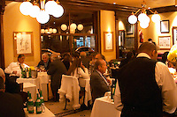 The main dining room at the restaurant full with dining guests and waiters serving. The Oviedo Restaurant, Buenos Aires Argentina, South America