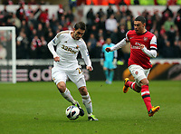 Pictured: Angel Rangel of Swansea (L) against Alex Oxlade-Chamberlain of Arsenal (R). Saturday 16 March 2013<br /> Re: Barclay's Premier League, Swansea City FC v Arsenal at the Liberty Stadium, south Wales.