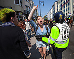 © Joel Goodman - 07973 332324 . 24/04/2011 . Brighton , UK . Police hold back antifascist protesters . Nationalist street movement March for England holds a march and rally in Brighton , opposed by antifascists . Photo credit : Joel Goodman