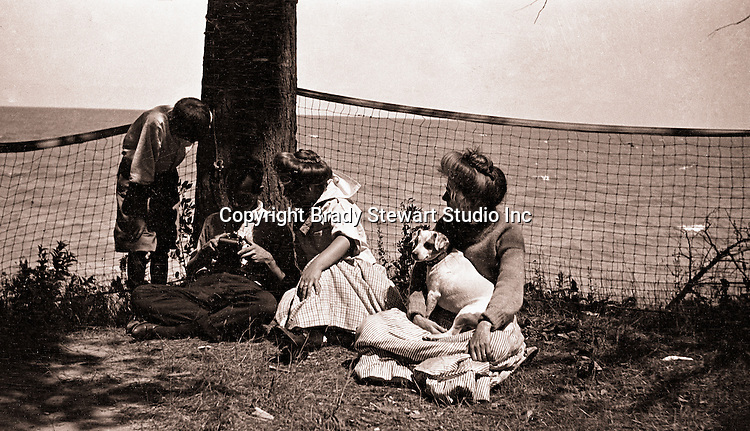 North East PA:  A view of Brady Stewart working on his camera while Homer Jr., Helen, Alice, and Peppy watch.  During the early 1900s, the Stewart family vacationed on Lake Erie near North East Pennsylvania. Since hotels and motels were non-existent, camping was the only viable option for a large number of vacationers