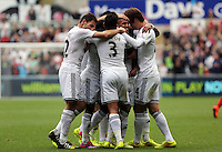 Pictured: Wayne Routledge of Swansea (2nd R) mobbed by team mates celebrating his goal, making the score 2-0 to his team. Saturday 30 August 2014<br /> Re: Premier League, Swansea City FC v West Bromwich Albion at the Liberty Stadium, south Wales, UK