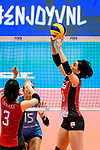 Koyomi Tominaga of Japan (R) serves the ball during the FIVB Volleyball Nations League Hong Kong match between Japan and Argentina on May 31, 2018 in Hong Kong, Hong Kong. Photo by Marcio Rodrigo Machado / Power Sport Images