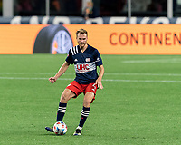 FOXBOROUGH, MA - APRIL 24: Henry Kessler #4 of New England Revolution passes the ball during a game between D.C. United and New England Revolution at Gillette Stadium on April 24, 2021 in Foxborough, Massachusetts.