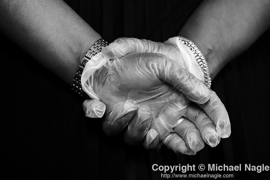 A woman wears gloves during the funeral for one year-old Davell Gardner Jr. at Pleasant Grove Tabernacle on July 27, 2020 in the Brooklyn borough of New York City.  Gardner was shot and killed earlier this month during a cookout in front of his home along with three others.  Photograph by Michael Nagle