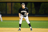 Wake Forest Demon Deacons first baseman Joe Napolitano (12) on defense against the West Virginia Mountaineers at Wake Forest Baseball Park on February 24, 2013 in Winston-Salem, North Carolina.  The Demon Deacons defeated the Mountaineers 11-3.  (Brian Westerholt/Four Seam Images)