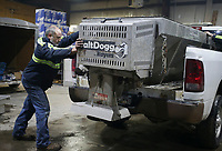 Mechanic Todd Peterson outfits a salt spreader to the bed of a truck, Friday, February 12, 2021 at the Benton County Roads Department in Bentonville. Check out nwaonline.com/210213Daily/ for today's photo gallery. <br /> (NWA Democrat-Gazette/Charlie Kaijo)