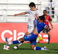 Alejandro Guido (10) of the United States is tackled by Victorino Zelaya (3) of El Salvador during the quarterfinals of the CONCACAF Men's Under 17 Championship at Catherine Hall Stadium in Montego Bay, Jamaica. The USA defeated El Salvador, 3-2, in overtime.