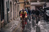 the peloton navigating the narrow slippery Mallorcan streets (during a downpour)<br /> <br /> Trofeo Lloseta - Andratx: 140km<br /> 27th Challenge Ciclista Mallorca