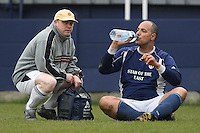 An injured Wounded Knee FC player receives treatment during the Hackney Gazette Cup Final at Leyton Football Club - 20/04/08 - MANDATORY CREDIT: Gavin Ellis/TGSPHOTO - Self billing applies where appropriate - Tel: 0845 094 6026