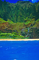 Kalalau valley with waterfall falling onto beach and cliffs, na pali north coastline of Kauai
