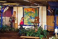 Woman walking through colorful Paliaku gardens in honaunau on the Big Island of Oahu