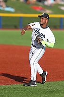 Fernery Ozuna (9) of the Hillsboro Hops throws before a game against the Salem-Keizer Volcanoes at Ron Tonkin Field on July 27, 2015 in Hillsboro, Oregon. Hillsboro defeated Salem-Keizer, 9-2. (Larry Goren/Four Seam Images)