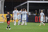 WASHINGTON, DC - AUGUST 25: Gustavo Bou #7 of New England Revolution celebrates his score with teammates during a game between New England Revolution and D.C. United at Audi Field on August 25, 2020 in Washington, DC.