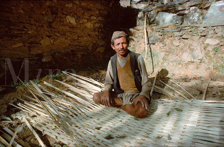 .Tamang (tribal) villager making wattle shelter, Everest trail, Nepal...