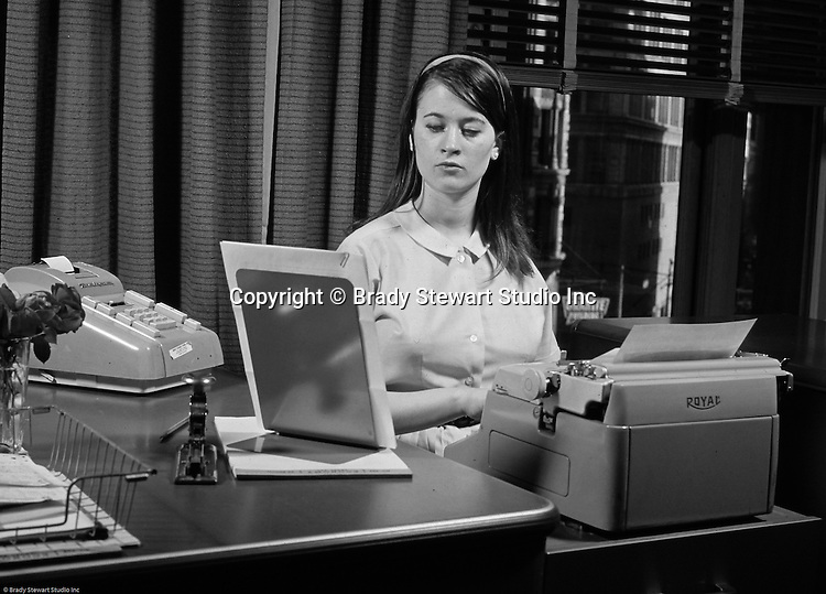 Pittsburgh PA:  View of a secretary typing a letter.  Cathy Stewart working in the offices of the National Union Insurance Company.  Cathy left Pittsburgh for New York City in 1969.  Over the next twenty years, she established herself as one of the top advertising executives in New York City.  Working for American Home Products, a few advertising agencies before becoming the highest-ranking woman at Shearson Lehman, American Express (VP of Marketing).