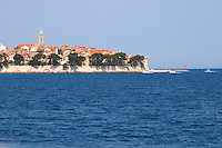 View across the sea on the town of Korcula on the island of the same name where Marco Polo was born. Korcula Island. Korcula Island. Dalmatian Coast, Croatia, Europe.