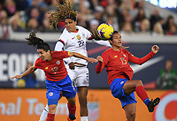 JACKSONVILLE, FL - NOVEMBER 10: Jessica McDonald #22 of the United States battle with Lixy Rodriguez #12 and Stephannie Blanco #15 of Costa Rica for a ball during a game between Costa Rica and USWNT at TIAA Bank Field on November 10, 2019 in Jacksonville, Florida.
