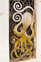 Copper carved octopus door in art deco district, Miami Beach, Florida