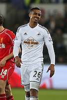 SWANSEA, WALES - MARCH 16: Kyle Naughton of Swansea in action during the Premier League match between Swansea City and Liverpool at the Liberty Stadium on March 16, 2015 in Swansea, Wales