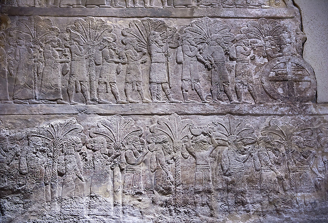 Stone relief sculptured panel of a the deportation of the Babylonians. From the palace of Ashurnasirpal II  , Niniveh, circa 645 BC. inv 19911  Louvre Museum , Paris