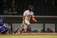 Scottsdale Scorpions center fielder Ronnie Dawson (4), of the Houston Astros organization, follows through on his swing in front of catcher Jhonny Pereda (6) during an Arizona Fall League game against the Mesa Solar Sox at Sloan Park on October 10, 2018 in Mesa, Arizona. Scottsdale defeated Mesa 10-3. (Zachary Lucy/Four Seam Images)