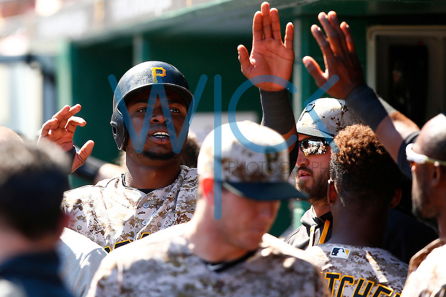 Gregory Polanco #25 of the Pittsburgh Pirates is congratulated by teammates in the dugout after scoring against the Detroit Tigers during the game at PNC Park in Pittsburgh, Pennsylvania on April 14, 2016. (Photo by Jared Wickerham / DKPS)