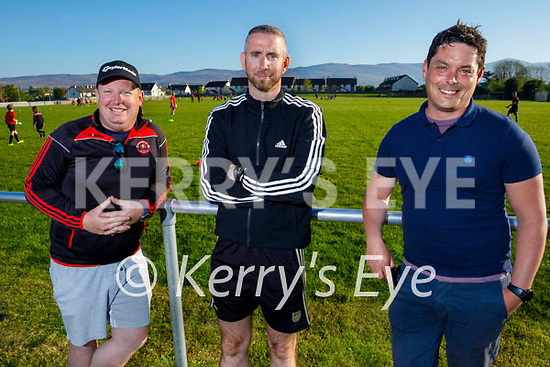 three delighted parents enjoying the return of St Brendans Park soccer training on Monday night. L to r: Danny McGuire, Brendan Smith and Jonathan Magner.