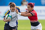 Hong Kong plays Kazakhstan during the17th Asian Games 2014 Rugby Womens Sevens tournament on October 01, 2014 at the Namdong Asiad Rugby Field in Incheon, South Korea. Photo by Alan Siu / Power Sport Images