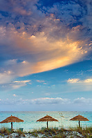 Reed umbellas and sunrise clouds. Turks and Caicos. Providenciales