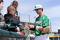 Dayton Dragons outfielder Jesse Winker #23 signs autographs before a game against the Bowling Green Hot Rods on April 21, 2013 at Fifth Third Field in Dayton, Ohio.  Bowling Green defeated Dayton 7-5.  (Mike Janes/Four Seam Images)