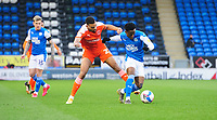 Blackpool's CJ Hamilton vies for possession with Peterborough United's Siriki Dembele<br /> <br /> Photographer Chris Vaughan/CameraSport<br /> <br /> The EFL Sky Bet League One - Peterborough United v Blackpool - Saturday 21st November 2020 - London Road Stadium - Peterborough<br /> <br /> World Copyright © 2020 CameraSport. All rights reserved. 43 Linden Ave. Countesthorpe. Leicester. England. LE8 5PG - Tel: +44 (0) 116 277 4147 - admin@camerasport.com - www.camerasport.com