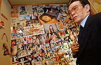 Issei Sagawa, the notorious Japanese cannibal, poses next to erotic photo collages in nhis bedroom. The collages contain images of Western and Asian  women he has dated and photographed. Sagawa killed and ate  Dutch student Renee Hartevelt while studying in Paris in 1981. He was released in Japan due to political connections after being jailed then placed in a mental institution in Paris. <br /> 14-DEC-05